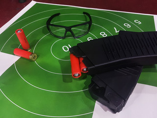 Picture of shooting gallery with target, glasses, gun