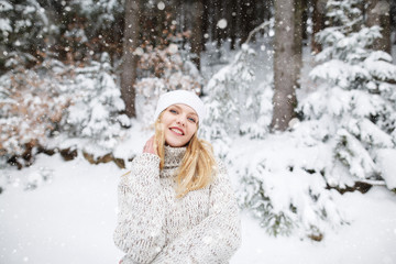 Young woman winter portrait. Expressing positivity, true brightful emotions. Beautiful blond hair girl i winter clothes