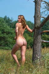 Beautiful young naked woman outdoors