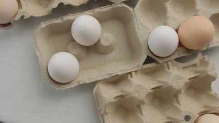 top view of eggs in boxes. Many different eggs with different shell color and texture