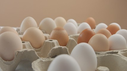 ecological eggs in boxes. Many different eggs in boxes