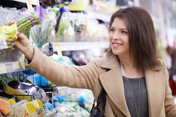 young woman buy fruits and vegetables at supermarket