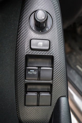 Electric windows and mirrors control buttons in the car