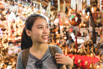 Tourist walking in bazaar, Bangkok, Thailand