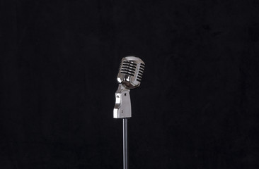 vintage microphone on a black isolated background