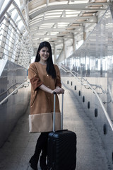 Portrait of beautiful woman, torism with travelling bag at airport preparing to travel in vacation .
