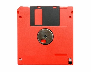 Red floppy disk isolated on white background. Obsolete technology concept.