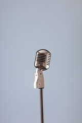 vintage microphone on a blue isolated background