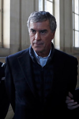 Former French budget minister Jerome Cahuzac, who was sentenced to three years in jail for hiding an offshore bank account, arrives for the appeals trial in his tax fraud case at the courtroom in Paris