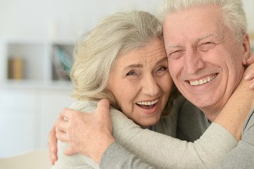 senior couple laughing  at home