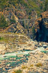 Two suspension bridges over beautiful Dhudh Kosi river not far from Namche Bazaar. Solukhumbu, Sagarmatha National Park, Nepal