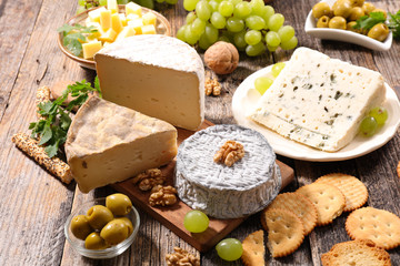 assorted cheese on wood background