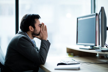 Picture of worried businessman working in office