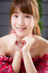 Beautiful young adult thai japanese Red Scottish Dress relax and smile