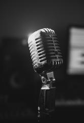 Retro microphone in home music studio. Black and white.