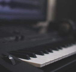 Midi keyboard and pc with music software. Concept of home music studio.
