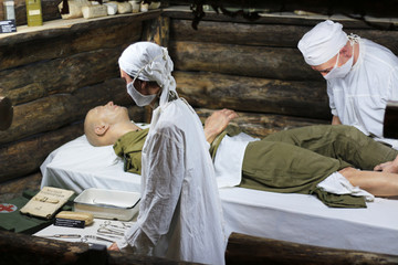 Exhibits of military doctors providing medical care