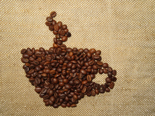 Coffee сup  figure from roasted coffee beans on burlap