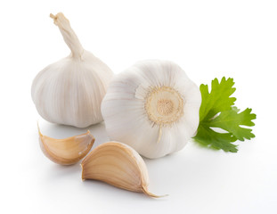 garlic with leaves of parsley isolated