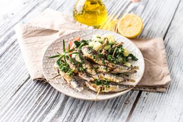 Healthy sardines with potato and chard