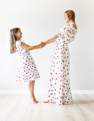 Happy mother and daughter dance together