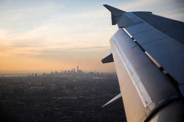 A view of New York City over a plane wing