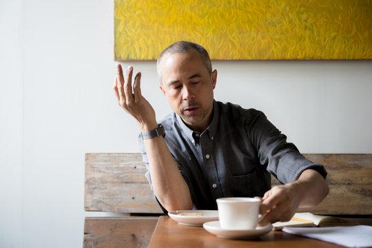 Man having breakfast and writing