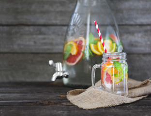 Glass of natural homemade lemonade by the jar