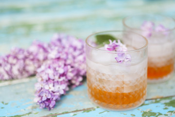 Lilac lemonade water with flowers