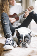 Woman and dog relaxing at home