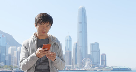 Man use of cellphone in Hong Kong