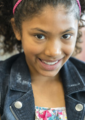 Close up of face of smiling mixed race girl