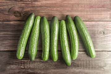 Cucumbers on wood background