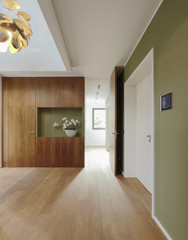 Plank floor and walnut wall covering in home