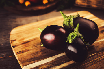 Eggplant on vintage wooden background