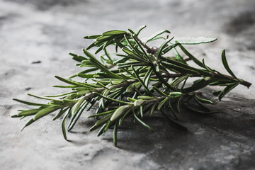 Rosemary on rustic background