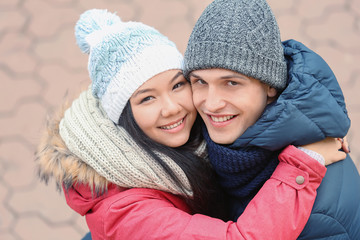 Cute couple in warm clothes outdoors