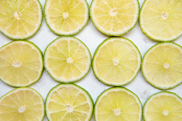 Lime slices in rows on a light background top view