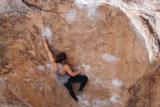 Strong Woman Bouldering Outside