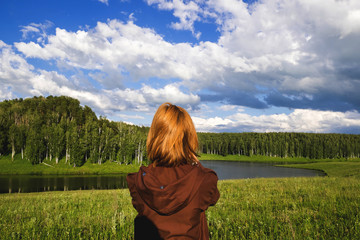 Woman admiring scenic view of river