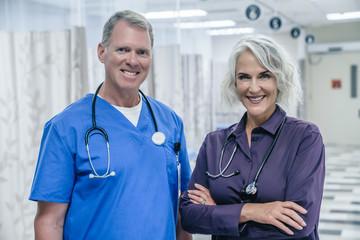 Portrait of smiling Caucasian doctors in hospital