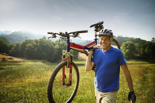 Caucasian man carrying mountain bike