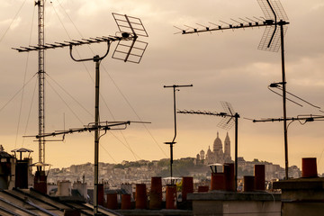 Antennas on rooftops in cityscape