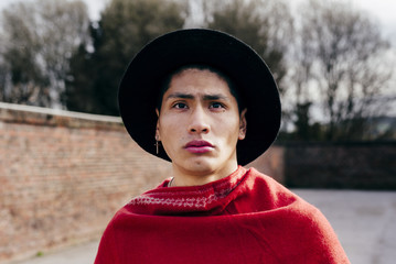 Asian man in red scarf and hat