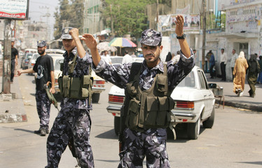 Members of Hamas security forces control the traffic on a street in southern Gaza