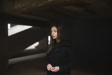 Pensive Caucasian woman wearing black coat