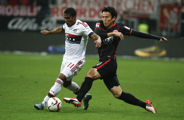 Eintracht Frankfurt Hasebe and Bayern Munich's Costa fight for the ball during their German first division Bundesliga soccer match in Frankfurt