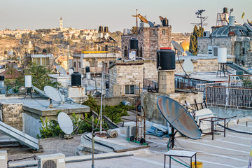 Jerusalem from the walls with black and white water storage tanks.