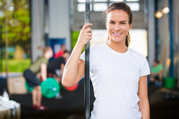 Smiling Female Athlete Wearing White Tshirt In Health Club