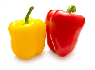 Large, red and yellow ripe peppers isolated on white background